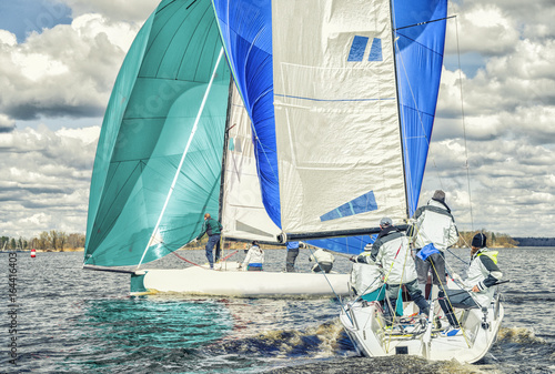 Foto op Aluminium Zeilen Sailing yacht race, regatta. Team athletes participating in the sailing competition