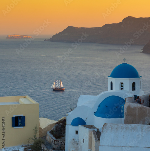 Santoronide blue-domed churches and sunset on the volcanic island, Greece