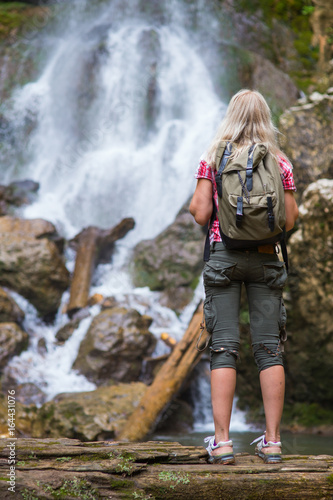 blonde woman tourist with backpack - 164431076