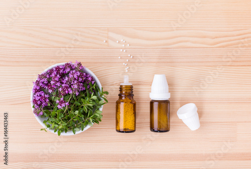 Homeopathic medicines / Homeopathic remedy with flowering wild thyme