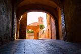 Medieval narrow street in Siena, Tuscany, Italy.