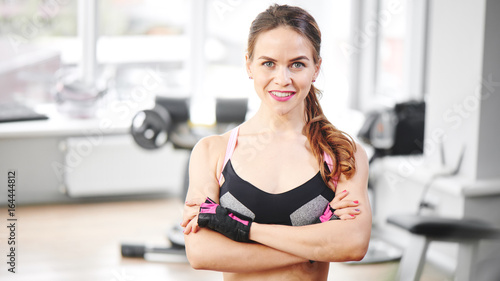 Portrait of a young girl on the background of the gym