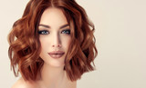 Beautiful model girl with short hair .Woman with red curly hair. Red head .  - 164454670