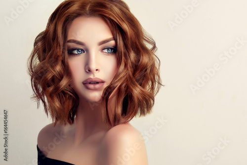 Fotobehang Kapsalon Beautiful model girl with short hair .Woman with red curly hair. Red head .