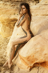 Beautiful naked woman with trace of car tire on her body