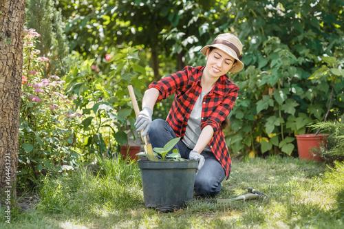 woman gardener planting flowers
