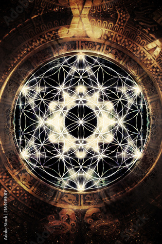 Light merkaba and flower of life in cosmic space. Sacred geometry.