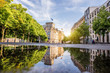 Street view with Reichtag building and beautiful reflection during the morning light in Berlin city