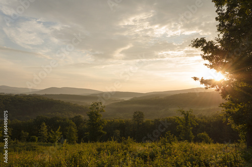 hills in morning light outdoor scene of green land. summer hiking landscape outdoor