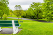 Empty bench in green plaines d'Abraham in morning during summer with road in Quebec City