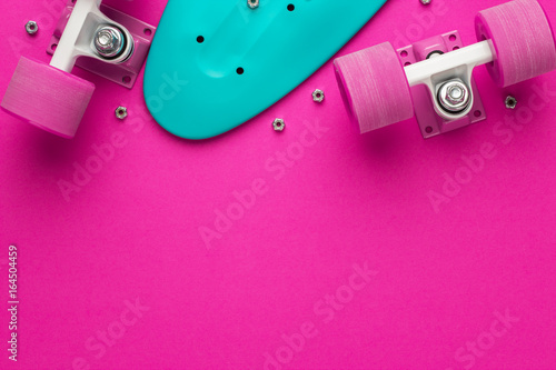 Plakat plastic mini cruiser board disassembled on deep pink with background copy space