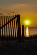 Wooden fence with sunset sky