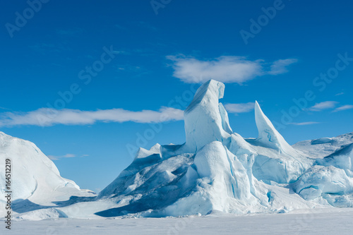 A jagged iceberg frozen into the sea ice in the Weddell Sea Antarctica.