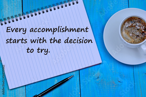 Every accomplishment starts with the decision to try on notepad Photo by deeaf