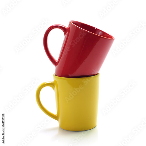 red and yellow mugs isolated on white background