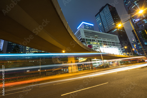 Foto op Aluminium Nacht snelweg urban traffic road with cityscape in background at night in Shanghai,China.
