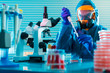 Research Of dangerous viruses in the laboratory. Prevention of a pandemic. A scientist in a biological protective suit works with a pipette - 164544285