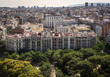 View from the height of the city of Barcelona with trees in the foreground - 164563011