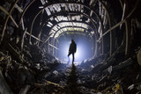 Silhouette of a man in an abandoned tunnel