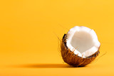 Fresh coconut on a bright yellow background