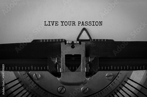 Text LIVE YOUR PASSION typed on retro typewriter Poster