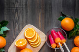 Oranges and citrus ice cream on wooden table background top view copyspace - 164604895