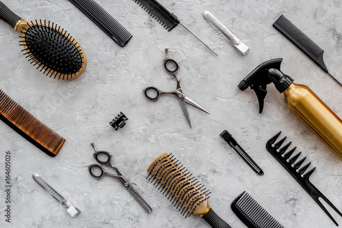 Pattern of combs and hairdresser tools on grey table background top view Poster