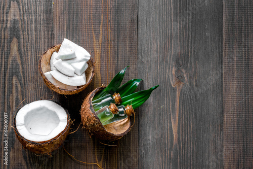 Skin care. Coconut lotion on wooden table background top view copyspace - 164606037
