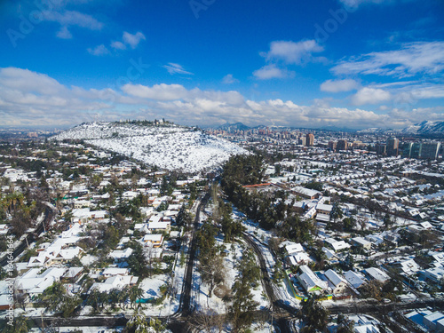 Staande foto Parijs Aerial drone shot of Santiago de Chile at winter. Snowy cityscape of the city