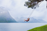 romantic girl on the swing, sweet dreams, daydream concept background - 164646072