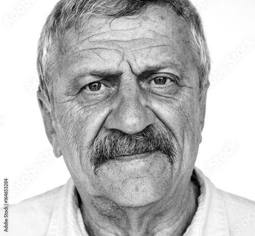 Senior adult man moody casual studio portrait