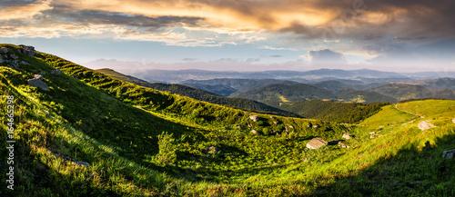 panorama of mountain ridge with peak at sunset