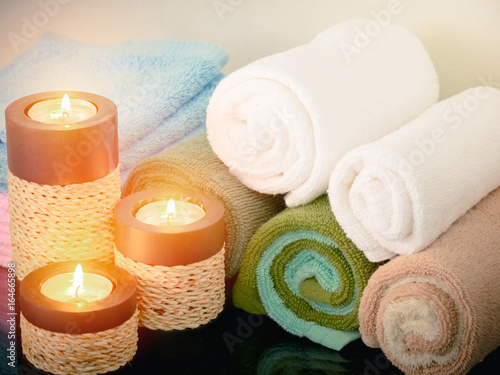 Towel with candle in bathroom,spa concept