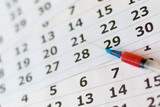 Syringe with red blood on a calendar blurred - 164666477