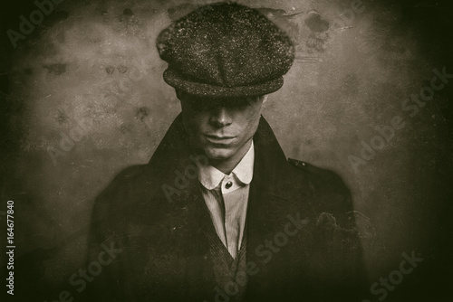 Antique wet plate photo of mysterious 1920s english gangster with flat cap.