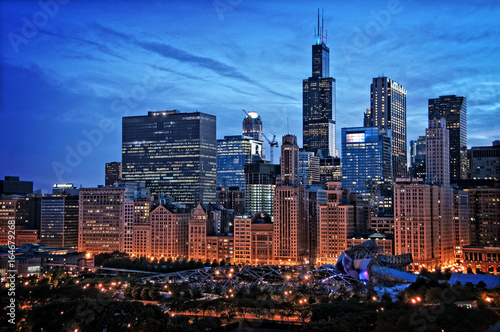 Poster Chicago Chicago lakefront skyline cityscape at night by millenium park with a dramatic cloudy sky.