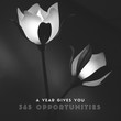A year gives you 365 opportunities. Inspirational life quote. Abstract background with Flowers. 2 Roses on a dark black  image.
