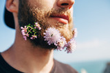 Flowers in the beard of a handsome man