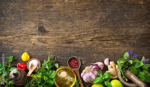 Fresh herbs and spices on wooden table - 164696250