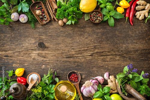 Zdjęcia na płótnie, fototapety na wymiar, obrazy na ścianę : Fresh herbs and spices on wooden table