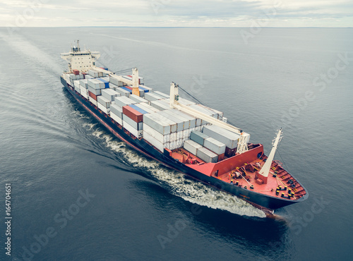 Fotobehang Zeilen Aerial view of container vessel sailing in open sea