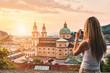 Leinwanddruck Bild - Tourist taking a photo of beatiful sunset in Salzburg Austria