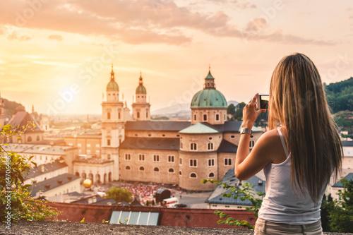 Leinwanddruck Bild Tourist taking a photo of beatiful sunset in Salzburg Austria