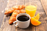 coffee cup with orange juice and croissant