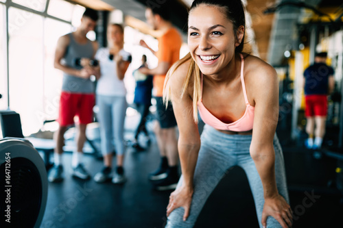 Sticker Close up image of attractive fit woman in gym