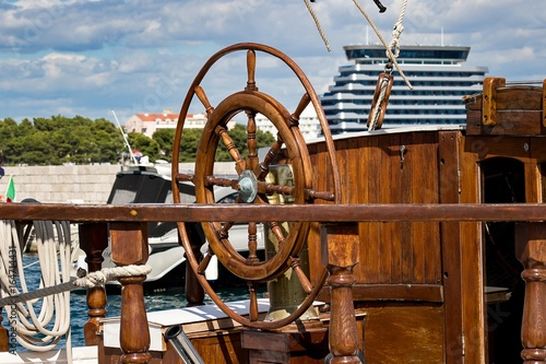 Wooden rudder on the boat