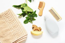Flat Lay Spa Cosmetics  Beige Cotton Towel Shampoo Bottle Wooden Comb Toy Horse And Green Leaves Of Currant Plants Hair Care Natural Organic Cosmetic Products Sticker