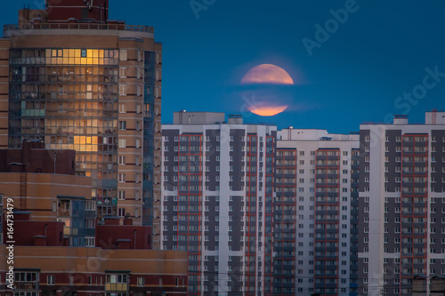 Big moon over the city.