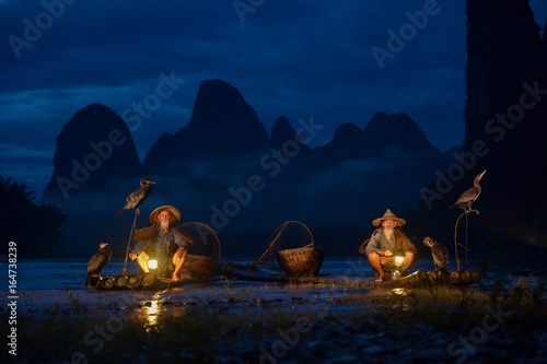 Fisherman of Guilin, Li River and Karst mountains during the blue hour of dawn,Guangxi China
