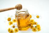 Still life of fresh honey and flowers